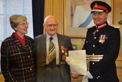 Adam Kelly receiving medal from Lord Lieutenant, Duke of Buccleuch