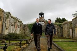 Colin Gilmour and Chris Bowles walking through the outdoor site of Auld Kirk in Selkirk