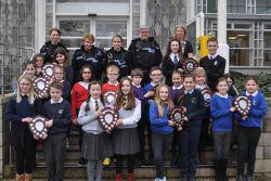 18 Primary school children with their awards at the front steps of council headquarters