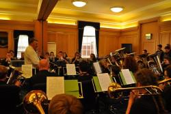 Borders Youth Brass Band playing in a reception room