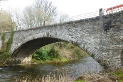 stone road bridge over a small river in the countryside