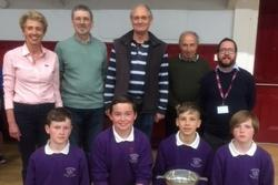 Councillors and school staff with Primary pupils holding their winners trophy