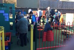 Adults and children at outdoor play area