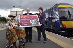 Darrin and Elizabeth pope with councillor John Greenwell at Tweedbank station