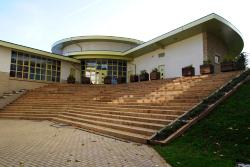 front of modern primary school building with wide steps leading to main entrance