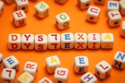 letter blocks with dyslexia spelled out