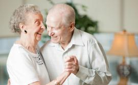 Elderly couple slow dancing