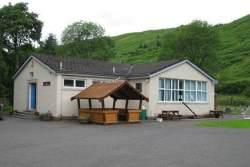 school building with children's play hut at the front
