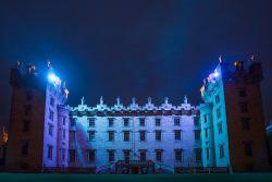 Floors Castel stately home lit up with blue lights against a night sky