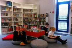 Children sitting on beanbags in a new library