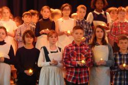 School pupils hold candles