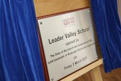 Leader school opening plaque on an easel with  curtain reveal