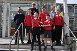 5 pupils with trophy and 3 council staff