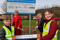 Pupils, Roseanna Cunningham, MSP, and David Parker burying a time capsule