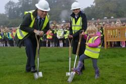 Cllr Sandy Aitchison, Sophia Bernie and Brodie Lawson (pupils from Broomlands primary school) cutting the sod
