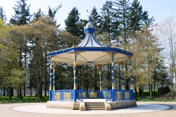 Blue and yellow bandstand in park land