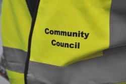 Fluorescent vest with 'community council' text on it