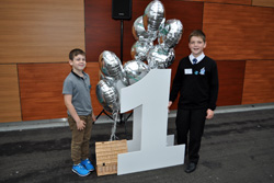 Caden and Jake Szoneberg on Borders Railway first anniversary at Waverley Station