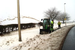 pavement gritter clearing snow