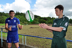 Graeme Anderson of Hawick Linden and Morgan Tait of Hawick Wanderers throwing and catching a rugby ball.