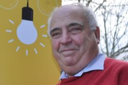 Close up of man's face with lightbulb image in background