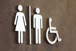public toilet women, men and disabled signs