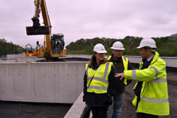 Selkirk Councillors Michelle Ballantyne and Gordon Edgar speak to Selkirk FPS Project Manager Conor Price at the site of the new Selkirk Recycling Centre.
