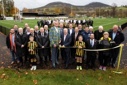 doddie weir councillor david parker melrose junior footballers and invited guests help to officially open the new melrose 3g pitch